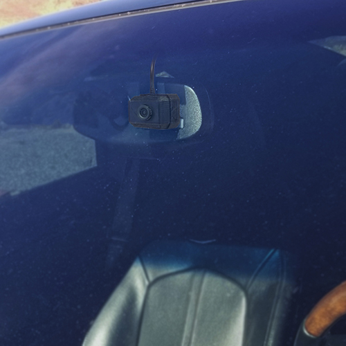 The Fly ICU Car Camera Mini Dash Cam - installed on rear view mirror