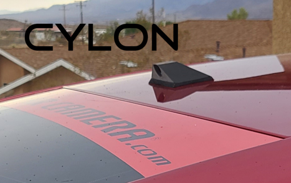 The Cylon ICU Car Camera is a Full-time REAR VIEW & Blind Spot Camera with wide-angle lens. Camera mounts to your roof or trunk for the best view or the road. Video Mirror Monitor attaches to your rear view mirror. - Installed on a 2014 Cadillac ELR